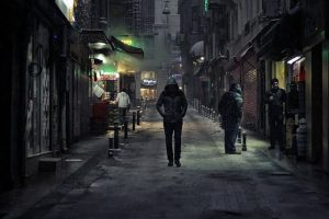 About a stranger who is walking in the street