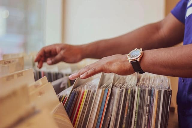A male is looking through a vinyl music collection