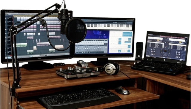 A music production desk with equipment