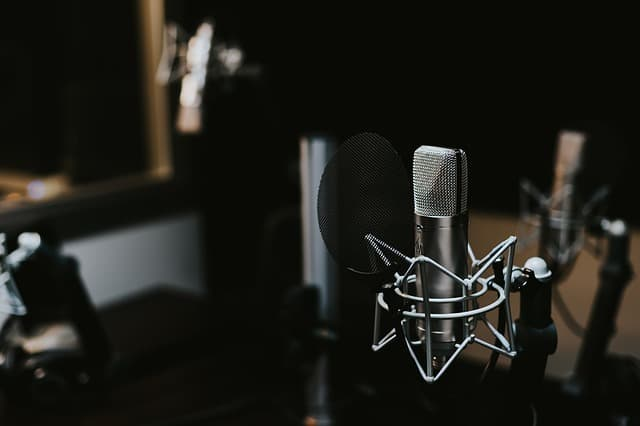 A microphone probably in a specialized recording environment that is blurred out