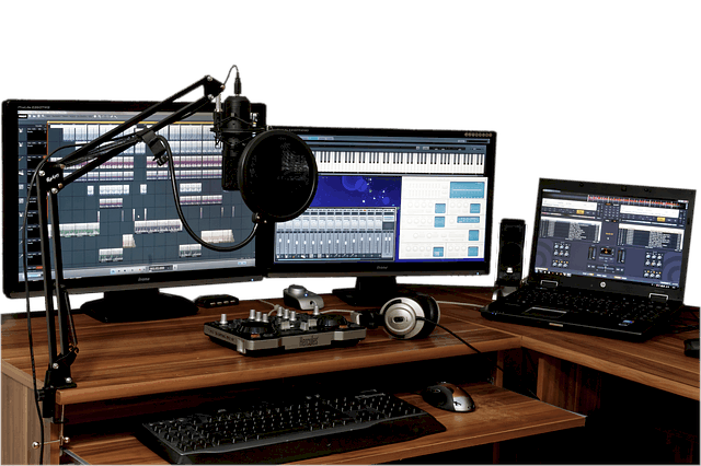 A music production studio with visible music production software and some hardware