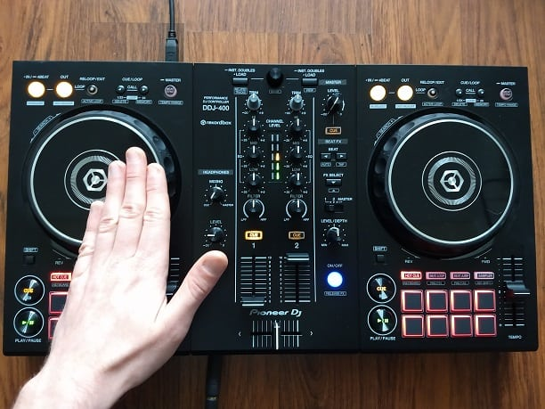 Touching the left platter of a DDJ-400 DJ controller from Pioneer DJ